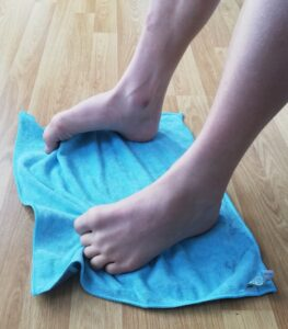Feet on a towel for strengthening exercises
