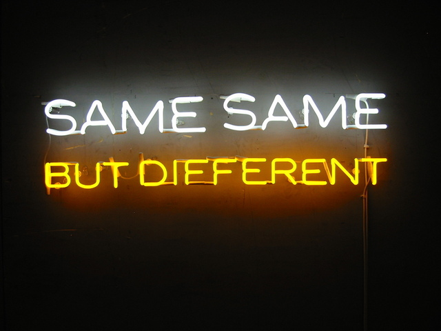 The words 'same same but different' in neon lights
