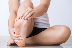 A woman performing foot stretches